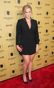 Amy Schumer styled her LBD with an elegant red satin clutch.