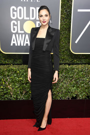 Gal Gadot balanced out her sexy dress with a menswear-chic jacket, also by Tom Ford.