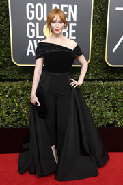Christina Hendricks was all about cool glamour in this black Christian Siriano off-the-shoulder gown and trousers combo at the 2018 Golden Globes.