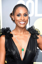 Issa Rae's Lorraine Schwartz diamond and emerald pendant necklace worked beautifully with her plunging dress!