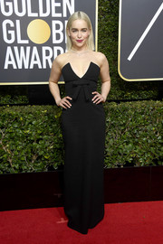 Emilia Clarke was sweet and sultry at once in a strapless black Miu Miu gown with a plunging neckline and bow detail at the 2018 Golden Globes.