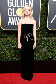 Dove Cameron looked darling in a Monique Lhuillier strapless column dress with metallic bow detailing at the 2018 Golden Globes.