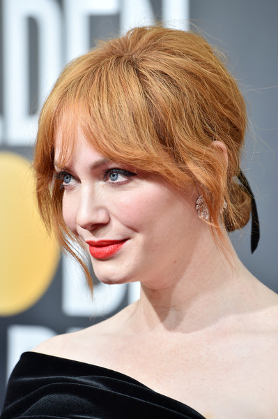 Christina Hendricks looked retro-chic wearing this chignon with a teased crown at the 2018 Golden Globes.