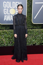 Alicia Vikander went the demure route in this beaded black gown by Louis Vuitton at the 2018 Golden Globes.