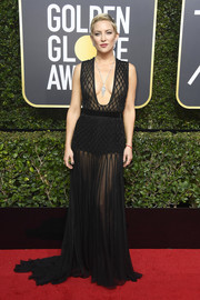 Kate Hudson looked mesmerizing at the 2018 Golden Globes in a sheer black Valentino Couture gown with a down-to-there neckline.