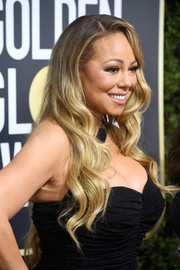 Mariah Carey looked sweet and glam with her long waves at the 2018 Golden Globes.