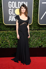 Lena Headey kept it feminine in a black lace-panel ruffle gown by Elie Saab at the 2018 Golden Globes.