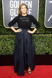 Connie Britton dressed up her casual top with a pleated black maxi skirt by Max Mara.