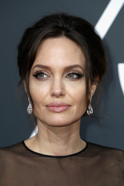 Angelina Jolie perfected her look with a pair of diamond drop earrings by Forevermark.