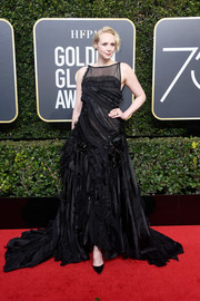Gwendoline Christie went the edgy route in a deconstructed-chic gown by Giles Deacon at the 2018 Golden Globes.