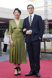 Sandra Oh styled her dress with black ankle-tie pumps by Christian Louboutin.