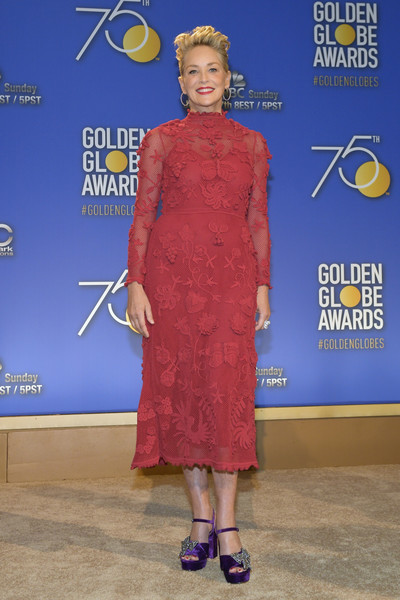Sharon Stone was chic and ladylike in an appliqued red cocktail dress by Valentino at the Golden Globe nominations announcement.