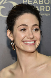 Emmy Rossum amped up the elegance with a pair of dangling multi-gemstone earrings by Irene Neuwirth.