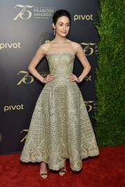 Emmy Rossum stunned in a gold  fit-and-flare strapless dress by Marchesa at the Peabody Awards.
