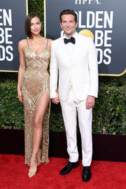 Irina Shayk wowed in a high-slit, beaded slip gown by Atelier Versace at the 2019 Golden Globes.