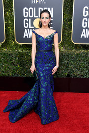 Camilla Belle made a head-turning entrance in a royal-blue Jason Wu mermaid gown with shimmering green embroidery at the 2019 Golden Globes.