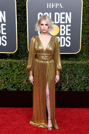 Lucy Boynton matched her dress with gold ankle-strap sandals by Nicholas Kirkwood.
