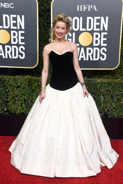 Amber Heard looked prom-ready in a strapless, drop-waist ball gown by Monique Lhuillier at the 2019 Golden Globes.