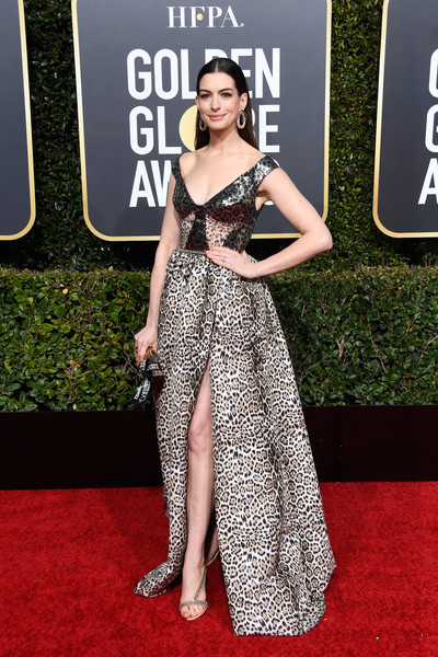 Anne Hathaway walked on the wild side in an off-the-shoulder leopard-print gown by Elie Saab at the 2019 Golden Globes.