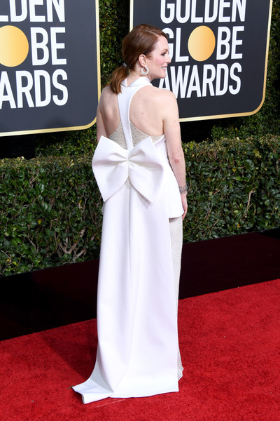 More Pics of Julianne Moore Ponytail (5 of 10) - Julianne Moore Lookbook - StyleBistro [red carpet,carpet,dress,clothing,gown,premiere,shoulder,flooring,hairstyle,fashion,arrivals,julianne moore,the beverly hilton hotel,beverly hills,california,golden globe awards]