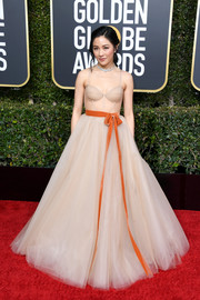 Constance Wu worked a sexy-meets-sweet nude corset gown by Vera Wang at the 2019 Golden Globes.