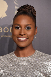 Issa Rae styled her hair into a braided bun for the 2018 Peabody Awards.