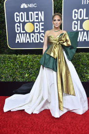 Jennifer Lopez was impossible to miss in her voluminous gold, green, and white Valentino Couture ballgown at the 2020 Golden Globes.