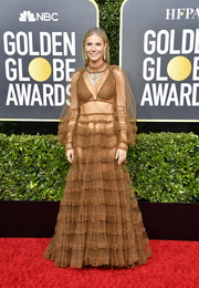 Gwyneth Paltrow flashed some skin in a sheer brown boho gown by Fendi at the 2020 Golden Globes.