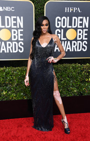 Winnie Harlow teamed her dress with a pair of midnight-blue platform sandals.