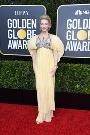 Cate Blanchett was a goddess in a pleated yellow empire gown with a bejeweled bodice and statement sleeves at the 2020 Golden Globes.