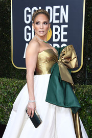 Jennifer Lopez paired a green satin clutch by Judith Leiber with a tricolor ballgown for the 2020 Golden Globes.