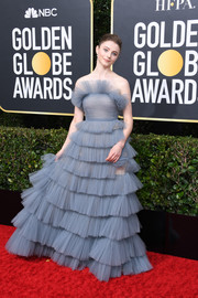 Thomasin McKenzie dolled up in a strapless slate-blue ruffle gown by Valentino Couture for the 2020 Golden Globes.
