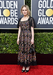 Anna Paquin chose a floral-embroidered Dior dress with a lace hem and sleeves for the 2020 Golden Globes.