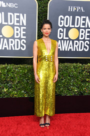 Gugu Mbatha-Raw styled her frock with a pair of bowed black sandals by Olgana Paris.