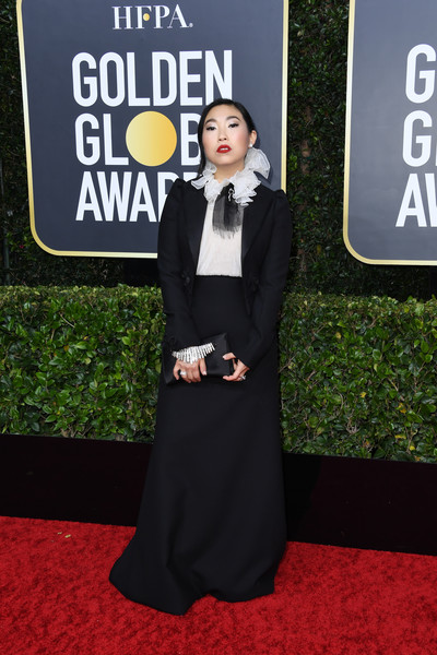 Awkwafina opted for a black Dior Couture maxi skirt suit paired with a white ruffle-collar blouse when she attended the 2020 Golden Globes.