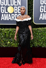 Cynthia Erivo looked dazzling in a heavily embellished black-and-white off-the-shoulder gown by Thom Browne at the 2020 Golden Globes.