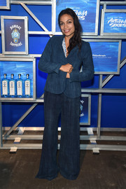 Rosario Dawson covered up in a blue bell-bottom pantsuit for the Bombay Sapphire Artisan Series finale.
