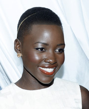 Lupita Nyong'o accessorized with a sweet pair of gold flower studs by Neil Lane during the Essence Black Women in Hollywood luncheon.
