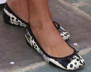 Angie Harmon wore a pair of comfy and cute black-and-white ballet flats to the Kidstock Music and Art Festival.