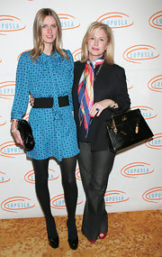 Kathy Hilton's croc-embossed black Kelly was a luxurious finish to her ensemble at the Lupus LA Bag Ladies luncheon.