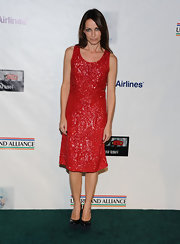 Sharon Corr wore this beaded crimson dress with black platforms to the pre-Academy Award party.