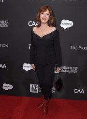 Susan Sarandon styled her black look with red lace-up boots.