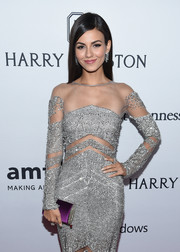 Victoria Justice paired a purple satin clutch with a beaded silver gown for the amfAR Inspiration Gala.