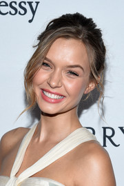 Josephine Skriver worked a messy-glam updo at the amfAR Inspiration Gala.