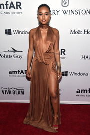Karrueche Tran was a bronzed bombshell in this cleavage-revealing, high-slit halter gown by Gucci at the amfAR Inspiration Gala.