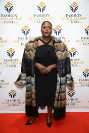 Danielle Brooks gave her LBD an opulent finish with a striped fur coat.