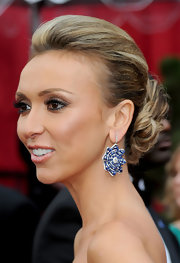Giuliana Rancic paired her twisted bun with sapphire dangling drop earrings.