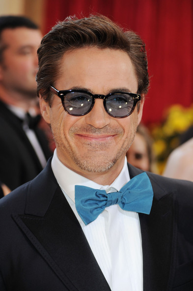 Robert complemented his bold bow tie with classic wayfarer-style Sheldrake Sunglasses.