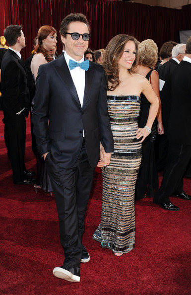 Robert looked stylish and polished in a tailored navy suit with a funky bow tie and dress sneakers.