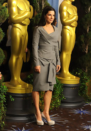 The Oscar winner sported some super high platform pumps with her structured grey ensemble. The neutral color added a leg-lengthening look and didn't distract from her detailed 2-piece look.